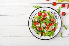 Easy vegetarian salad with figs, strawberries, grapes, blue cheese Stock Photography