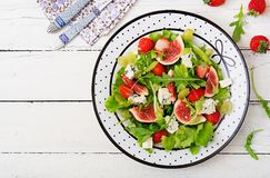 Easy vegetarian salad with figs, strawberries, grapes, blue cheese. `Dorblu` and lettuce. Flat lay. Top view Royalty Free Stock Photo