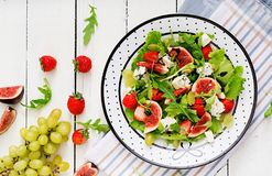 Easy vegetarian salad with figs, strawberries, grapes, blue cheese Stock Image