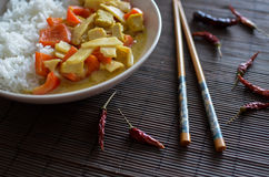Easy vegetarian thai green curry sauce with basmati rice made from red peppers, chilli peppers, tofu and bamboo shoots Stock Photos