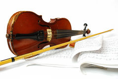 Easy Violin Still Life. Violin with the bow and violin rosin on a white background and music books Royalty Free Stock Photos