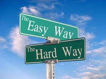 The Easy Way, or Hard Way. Street sign that reads Easy Way, Hard Way - great concept background stock photos