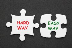 Easy Way Hard Way. Easy Way vs Hard Way text in 2 pieces paper puzzle on black background. Business concept stock image