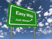 Easy way just ahead. A traffic sign against the blue skies with the text 'easy way just ahead royalty free stock images