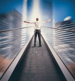 Easy way to success. Concept of Easy way to success with businessman and escalator stock images