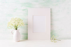Easy white frame mockup with tender wild flowers in pitcher Royalty Free Stock Photos