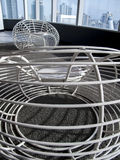 Easy white  wire chair. In the office building Royalty Free Stock Photo