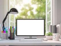 Easy white working desk with blank computer monitor screen 3d rendering image. There are open window  look out to see the nature Royalty Free Stock Images