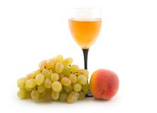Easy wine with a peach. Peach with grapes and easy wine on a white background Stock Photo