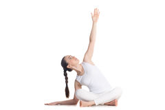 Easy yoga pose with side bend Royalty Free Stock Photography