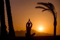 Easy yoga pose Silhouette Stock Photos