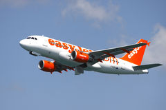 Easyjet easy jet aircraft. Easy jet / Easyjet aircraft takes off from Gibraltar Airport. Plane in flight royalty free stock images