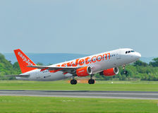 Easyjet Airbus A320 Commercial Airliner. Easyjet Airbus A320 taking off from Manchester Airport royalty free stock photography