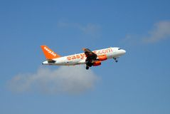 Easyjet Airbus A319. Easyjet Airbus A319 aeroplane taking off against a blue sky royalty free stock photos
