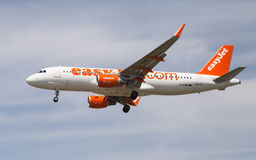 Easyjet Airbus A320. An Easyjet Airbus A320 approaching to the El Prat Airport in Barcelona, Spain royalty free stock photography