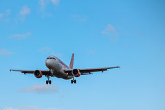 Easyjet airbus. In flight front view landing gear down blue sky Stock Images