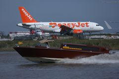 EasyJet Airbus landing in Venice Marco Polo Airport VCE. EasyJet plane landing in Venice Marco Polo Airport VCE, Water bus on canal stock photos