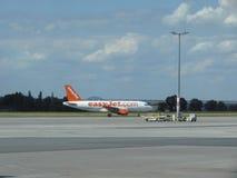 Easyjet Airbus A319 on the runway. PRAGUE, CZECH REPUBLIC - CIRCA JULY 2016: Air Dolomiti Embraer ERJ-195LR (ERJ-190-200 LR) on the runway Royalty Free Stock Images