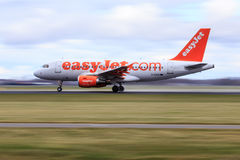 Easyjet Airbus A319 take-off. Motion blur of an Easyjet Airbus A319 taking off at high speed royalty free stock image