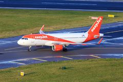 Easyjet Airbus A320 taxiing. On a taxiway royalty free stock photo