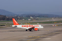 EasyJet Airbus A319-111 in the Zurich airport. Kloten, Switzerland - 28 March, 2017: Airbus A319-111 of EasyJet taxiing in the Zurich airport. EasyJet styled as Stock Photography