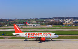 EasyJet Airbus A319-111 in the Zurich airport. Kloten, Switzerland - 28 March, 2017: Airbus A319-111 of EasyJet taxiing in the Zurich airport. EasyJet styled as Stock Photo