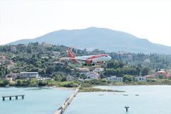 EasyJet aircraft landing. At the international airport at Corfu Island, Greece royalty free stock photography
