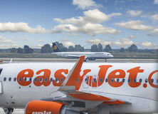 Easyjet Aircraft with Lufthansa Aircraft in the bakground Royalty Free Stock Images