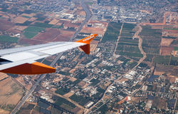 EasyJet aircraft winglet above aerial bird view on Central Districts of Israel. TEL-AVIV, ISRAEL - JUNE 25, 2017: EasyJet aircraft winglet above aerial bird view Stock Photo