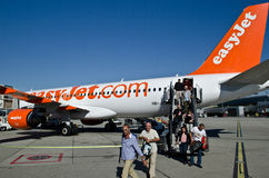Easyjet airline and passengers. In Geneva international arport royalty free stock image
