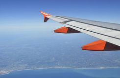 EasyJet airplane. Flying over the French Atlantic coast royalty free stock photos
