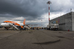 Easyjet airplane at Marseille airport , France. Easyjet airplane off-loading passengers on tarmac at Marseille airport in france. Marseille MP2 stock image