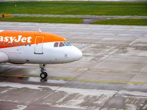 EasyJet airplane, Zurich, Switzerland. EasyJet airline aircraft taxiing on runway at Zurich, Switzerland airport royalty free stock photography