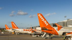 Easyjet airplanes and airport personnel at London`s Gatwick airport - South Terminal Stock Photo