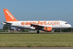EasyJet. British easyJet Airbus A319-100 old livery with registration G-EZIP just landed on runway 18R Polderbaan of Amsterdam Airport Schiphol stock images