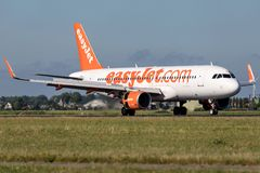 EasyJet. British easyJet Airbus A320-200 old livery with registration G-EZOA just landed on runway 18R Polderbaan of Amsterdam Airport Schiphol stock image