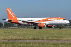EasyJet. British easyJet Airbus A320-200 with registration G-EZUK just landed on runway 18R Polderbaan of Amsterdam Airport Schiphol stock images