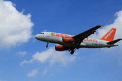 Easyjet in clouds Royalty Free Stock Photo