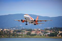 EasyJet Greece. CORFU, GREECE - JUNE 5, 2016: EasyJet Airbus A319 takes off from Corfu International Airport, Greece. With 65 million passengers carried in 2014 stock image