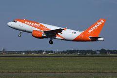 Easyjet plane taking off. Easyjet jet takes off from runway stock image