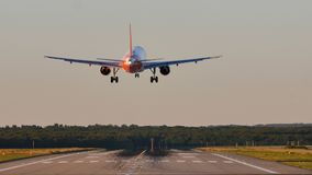 EasyJet plane landing on runway. View from back tail royalty free stock photography