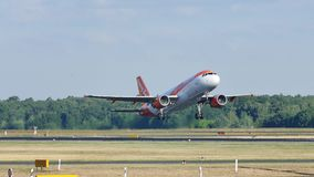 EasyJet plane taking off from airport. EasyJet aircraft taking off from airport to vacation destination stock footage