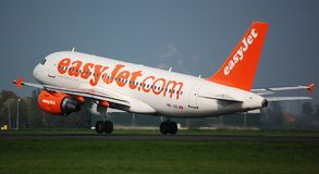 Easyjet takes off. An Easyjet Airbus 319 takes off from Amsterdam Airport Schiphol stock images