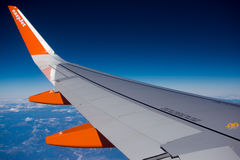 Easyjet wing. Easyjet airplane wing in flight royalty free stock photo