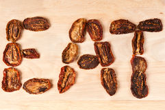 Eat. The word eat made of dried tomatoes Stock Image