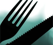 Eat?. Knife and fork Stock Photo