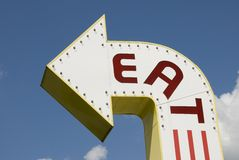 Eat. A three-dimensional metal EAT sign in a sans-serif typeface stock photo