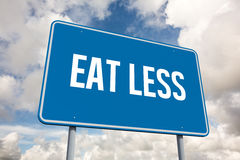 Eat less against blue sky with white clouds Royalty Free Stock Image