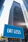 Eat less against skyscraper in city Royalty Free Stock Images