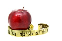 Eat away. An apple and tape measure Stock Image